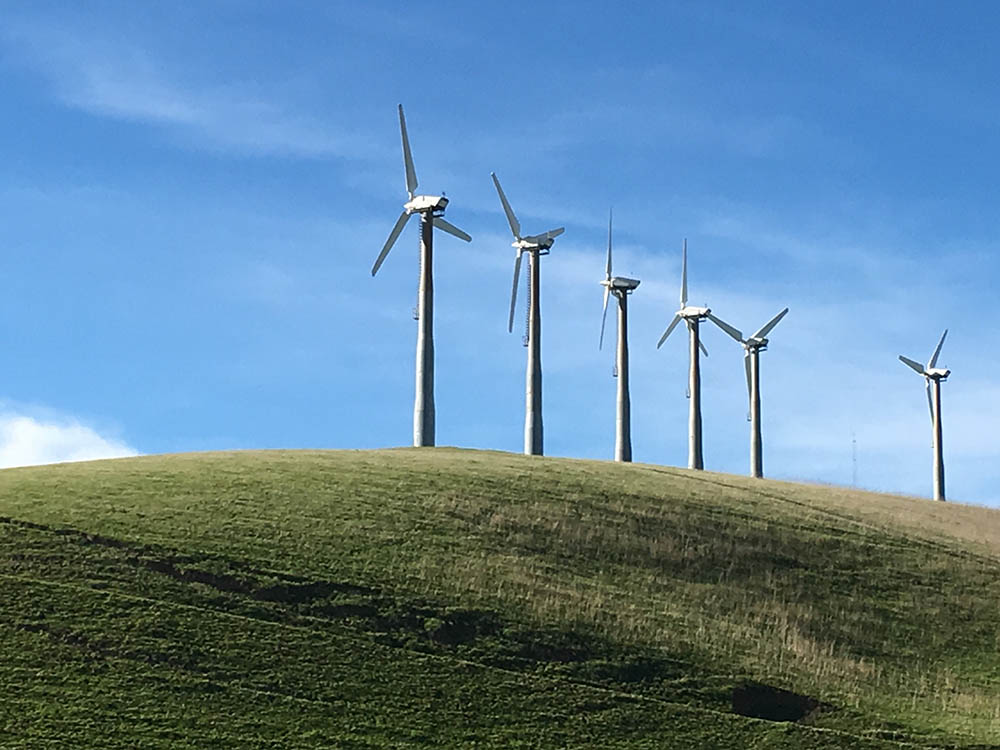 air turbines on green grass